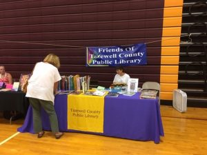 Image of the Friends of the library setting up a table at the 2019 Quilt Show in Bluefield, VA
