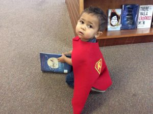 Image of a Child with super reader cape for 1000 Books Before Kindergartenen