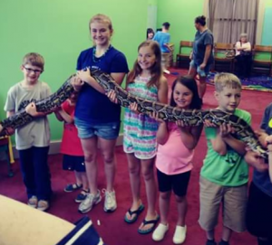 Image of Kids holding snake at Richlands Library